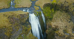 Aerial view of the waterfall Gljufrabui in Iceland. River flows in the green valley and falls down from the mountain. stock footage