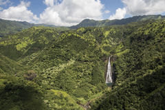 Aerial view of waterfall Manawaiopuna Falls, used in Jurassic park, Kauai, Hawaii Royalty Free Stock Images