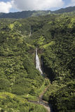 Aerial view of waterfall Manawaiopuna Falls, used in Jurassic park, Kauai, Hawaii Royalty Free Stock Photos