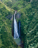 Aerial view of waterfall in mountains of Kauai. Waterfall from the air over Kauai royalty free stock images