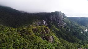 Aerial view of waterfall in Sri Lanka at high altitude under the clouds stock video footage