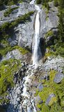 Aerial view of a waterfall in Val di Mello. Val Masino, Valtellina, Sondrio. Italy. Aerial view of a waterfall in Val di Mello, a green valley surrounded by Royalty Free Stock Photos