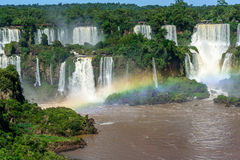 Aerial view of waterfalls cascade of Iguazu Falls with extensive tropical forest and beautiful rainbow in Iguacu National Park Stock Photo