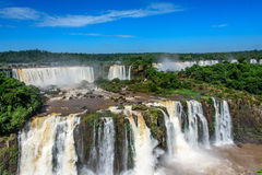 Aerial view of waterfalls cascade of Iguazu Falls with extensive. Tropical forest and powerful flows of water in Iguacu National Park, UNESCO World Heritage Stock Image