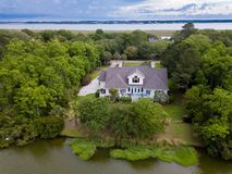 Aerial view of home on wooded property stock images