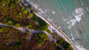Aerial view of wave, sea and sandy beach. Perspective is straight down. stock video