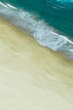 Aerial view of waves crashing on beach Royalty Free Stock Image
