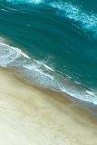 Aerial view of waves crashing on beach vertical image. Aerial view of tropical beach high angle view travel or summer concept Royalty Free Stock Photos