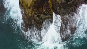 Aerial view of waves crashing on the rocks.  stock video