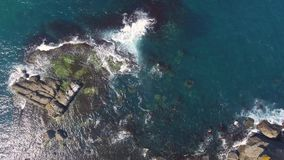 Aerial View Of Waves Crashing Rocks. Windy day at sea dangers rocks stock video footage
