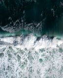 Aerial view of a waves crashing and rolling in the ocean. royalty free stock photo