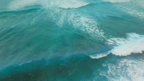 Aerial view of waves foam and seabed stock footage
