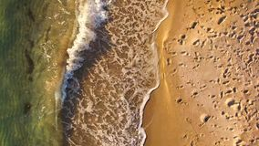 AERIAL VIEW. Waves Splashing Along The Beach In Crimea. AERIAL VIEW. This is an aerial view over sandy beach with waves of emerald sea water gently splashing the stock video