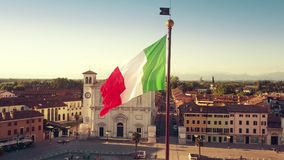 Aerial view of waving Italian flag in the very center of the town of Palmanova, Italy Royalty Free Stock Images