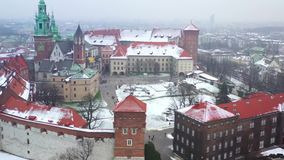 Aerial view of Wawel royal Castle and Cathedral, Vistula River, park, promenade and walking people in winter. Poland stock video
