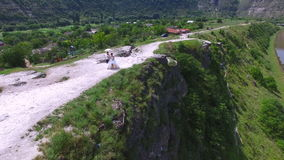 Aerial view of wedding couple having a walk on a cliff above river stock footage