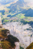 Aerial view of Wengen. Aerial view of the Swiss village of Wengen, are their houses and mountains on a sunny day, it´s a vertical picture Royalty Free Stock Images