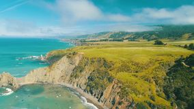 Aerial view of west coast with mountains lifts and ocean waves stock video footage