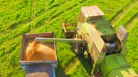 AERIAL VIEW. Wheat Harvesting stock video footage