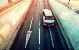 Aerial view of white car exiting underground garage Royalty Free Stock Photography