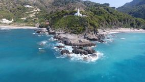 Chapel on the Cape 1. Aerial view of a white chapel on an exotic cape stock footage