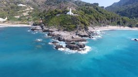 Chapel on the Cape 2. Aerial view of a white chapel on an exotic cape stock footage