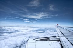 Aerial view of white cloud and blue sky from plane window. Aerial view of white    cloud and blue sky from plane window Royalty Free Stock Images