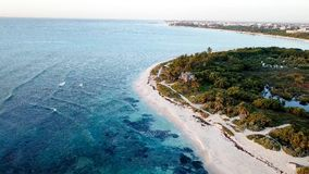 Aerial View of White Sand Beach With Green Trees and Clear Crystal Water royalty free stock image