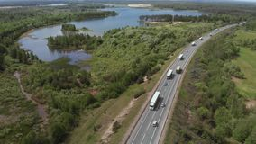 Aerial View of White Truck Passing Busy highway/ Highway Overpass/ Overdrive/ Bridge. Cars and trucks go on the road on