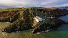 Aerial view. Wicklow Head lighthouse. county Wicklow. Ireland. Aerial view of the old s. XVIII and new Wicklow Head lighthouses. county Wicklow. Ireland royalty free stock photo