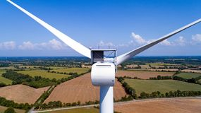 Aerial photo of a wind turbine in a field Royalty Free Stock Photos