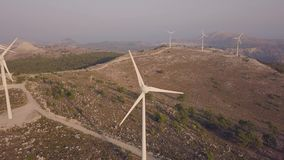 Aerial view of wind farms. On hills stock video