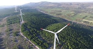 Aerial view of wind power generators stock video
