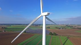 Aerial view on wind power, turbine, windmill, energy production - clean and renewable energy.  stock video footage