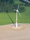 Aerial View : Wind turbine in a field. Aerial View : Wind turbine in fields along a highway Stock Images