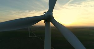 Aerial view of wind turbine at sunset