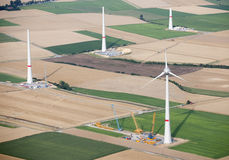 Aerial View : Wind turbines construction site. Aerial View : Huge wind turbines construction site close by some cranes Stock Image