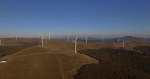 Aerial 4K Footage Of Renewable Energy Wind Turbine Farm. Aerial view of Wind turbines Energy Production- 4k aerial shot stock video footage