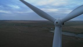 Aerial view of Wind turbines Energy Production- 4k aerial shot on sunset. 4k drone footage turbines at sunrise with