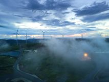 Aerial view Wind turbines and fog for generating electricity in Southeast Asia. Stock Image