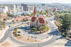 Aerial view of Windhoek with the Christuskirche in front. WINDHOEK, NAMIBIA - JUNE 17, 2017: An aerial view of Windhoek central business district with the royalty free stock image