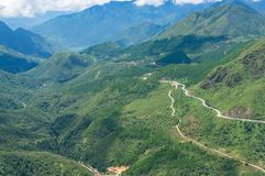 Aerial view of winding mountain road and magnificent valley Stock Photography