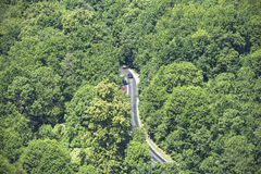 Aerial view of winding road through forest. Stock Photography