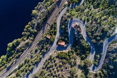 Aerial view of a winding road and train tracks along the Tagus River near the village of Belver in Portugal. Concept for travel in Portugal stock images
