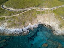 Aerial view of winding roads of the French coast. Corsica. Coastline. France Royalty Free Stock Photo