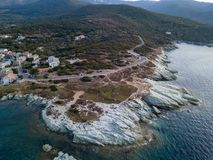 Aerial view of winding roads of the French coast. Village of Barcaggio. Corsica. Coastline. France Royalty Free Stock Photos
