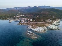 Aerial view of winding roads of the French coast. Village of Barcaggio. Corsica. Coastline. France Stock Photos