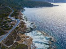 Aerial view of winding roads of the French coast. Village of Barcaggio. Corsica. Coastline. France Royalty Free Stock Images