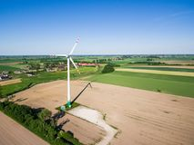 Aerial view of windmill at the countryside. Under blue clear sky Royalty Free Stock Images
