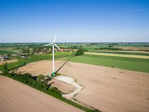 Aerial view of windmill at the countryside. Under clear blue sky Royalty Free Stock Images